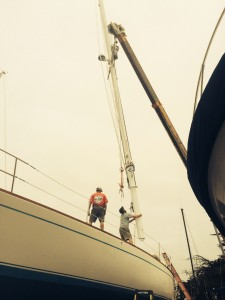 Stepping the mast.
