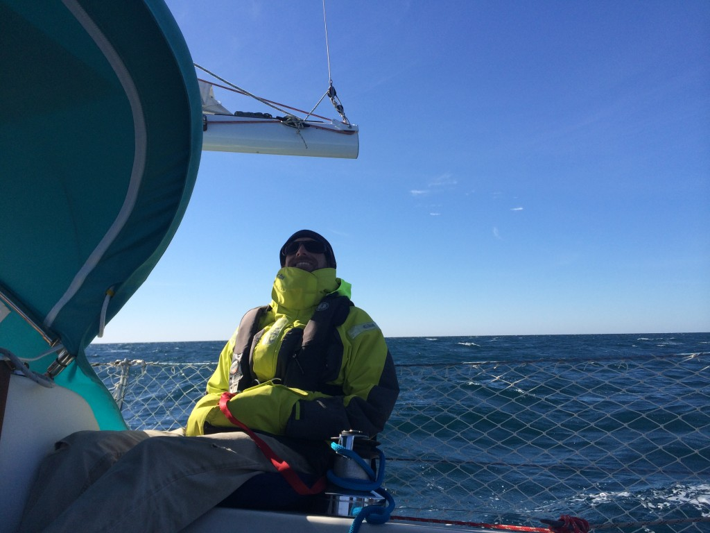 He didn't sleep much, but he's skilled at catching a snooze. Underway the next morning in the cold wind.