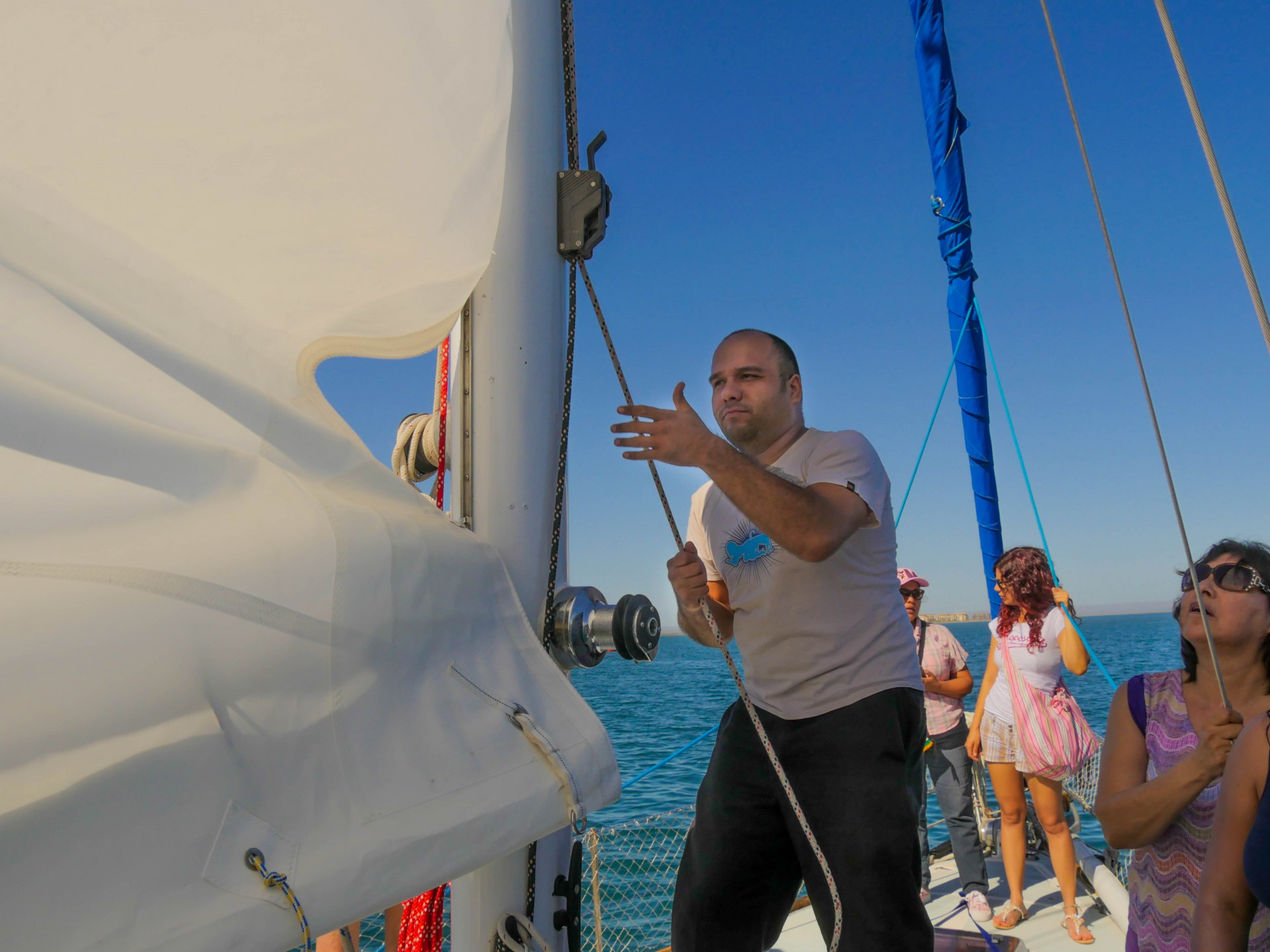 Alfonso hoists the sail.