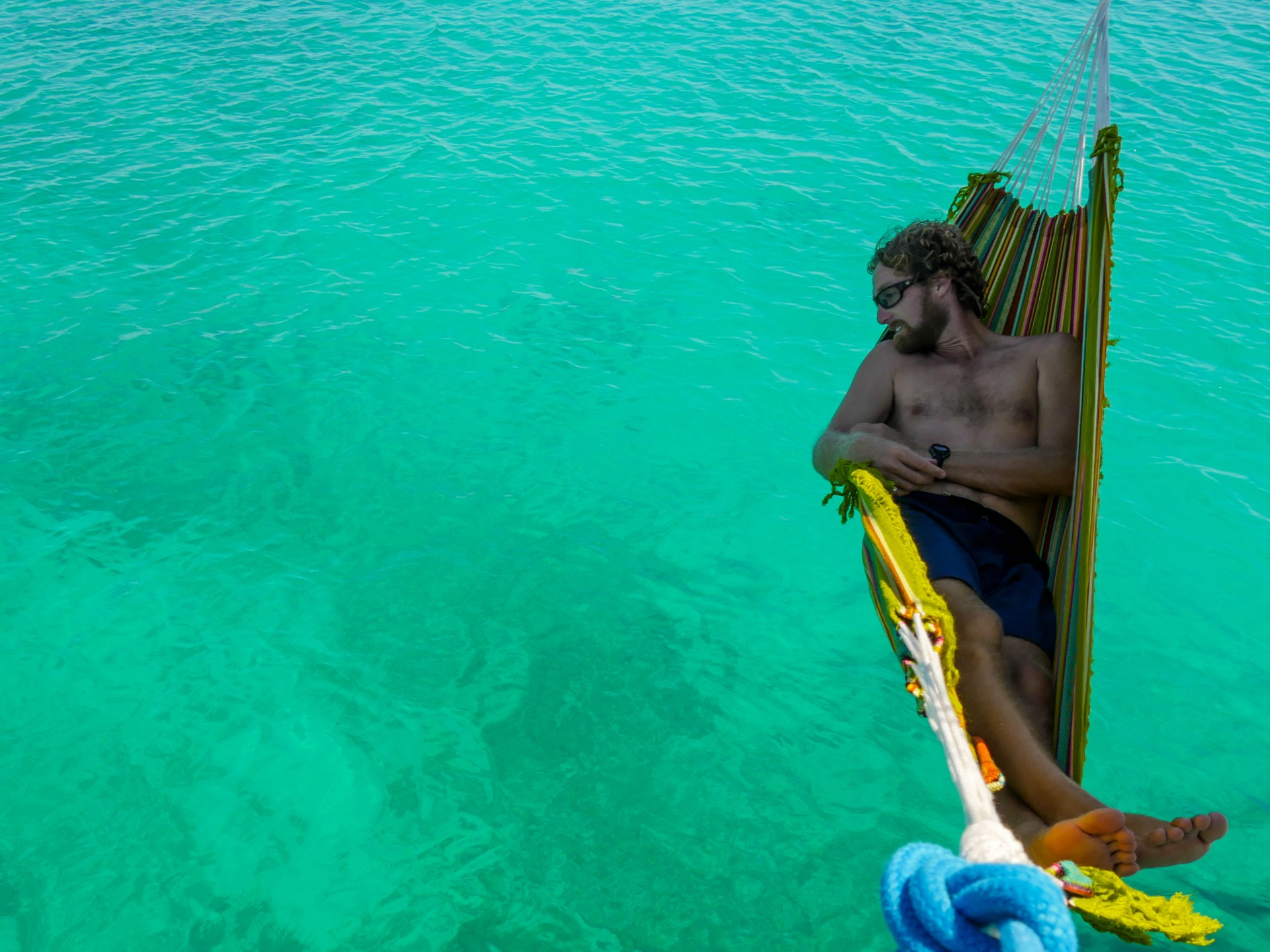 Josh set up our hammock and enjoyed the sliver of shade from the boom over the water.