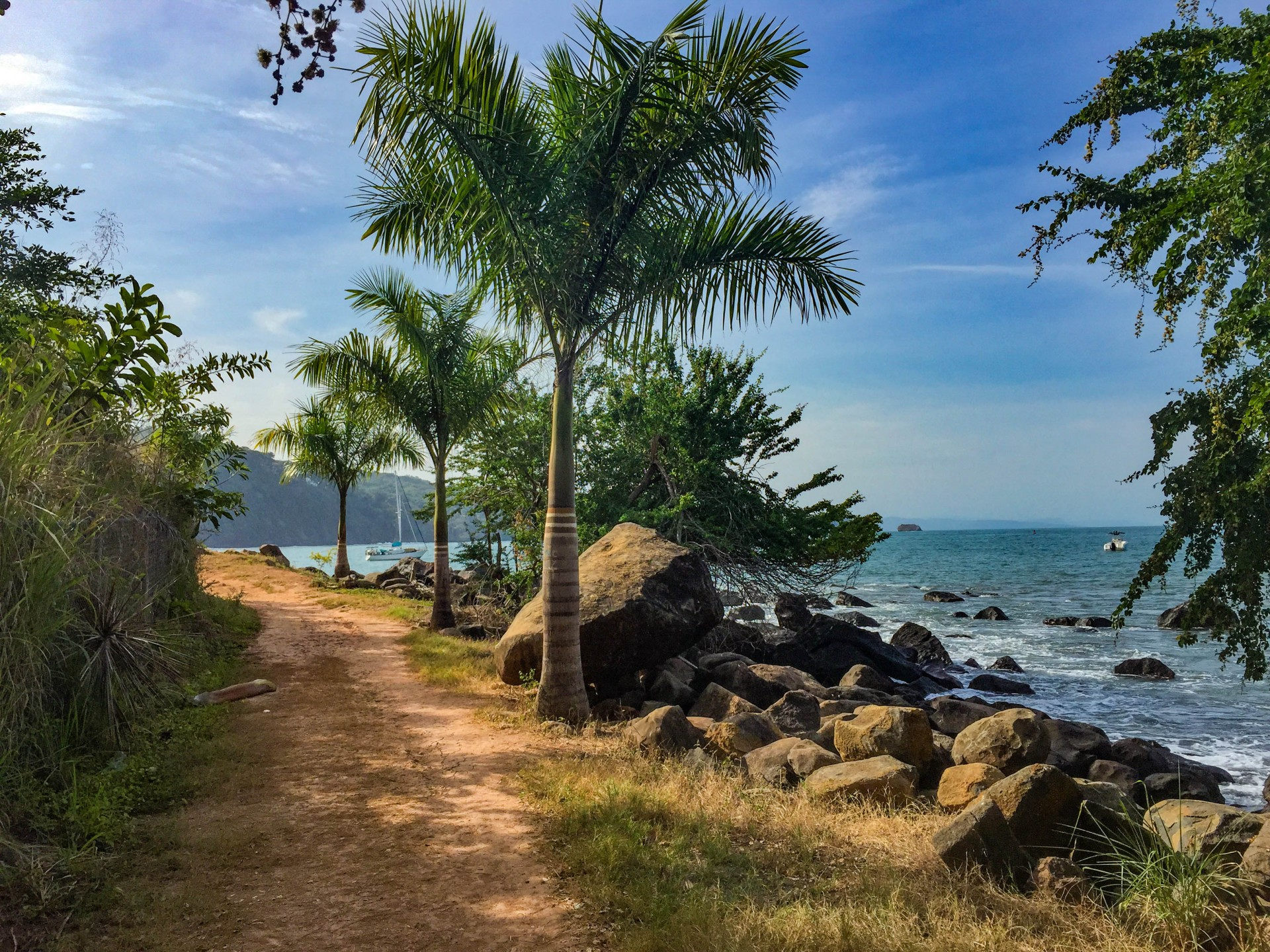 The Chacala path, with a view to our steady vessel in the palms.